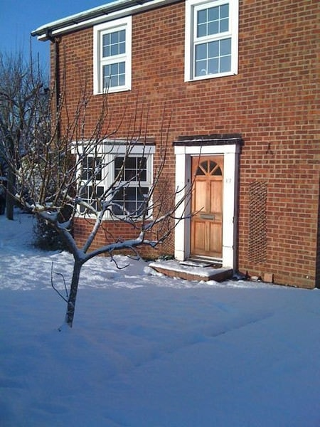 House - old front-door in the snow