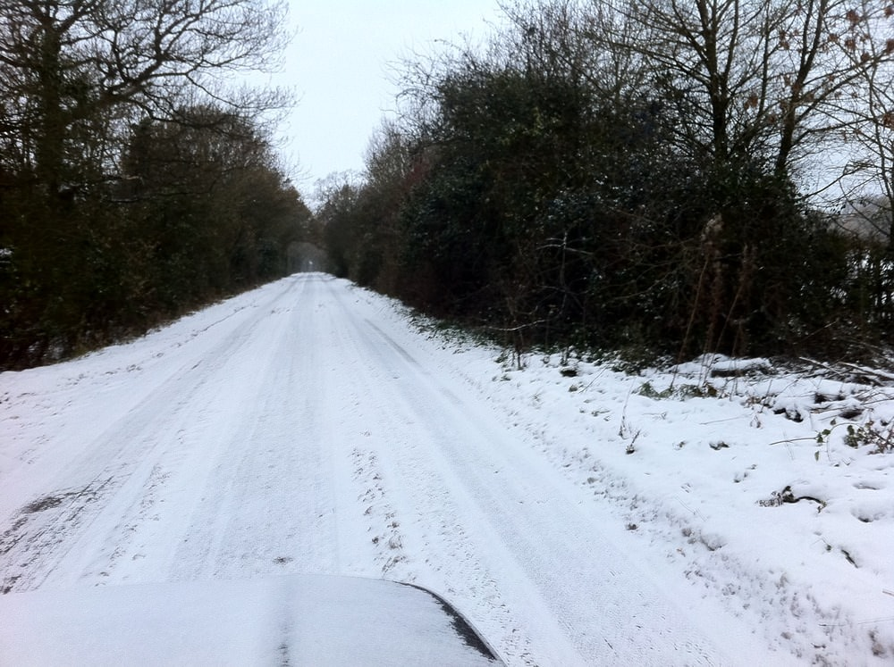 Not snowed in… but very icy roads around here!